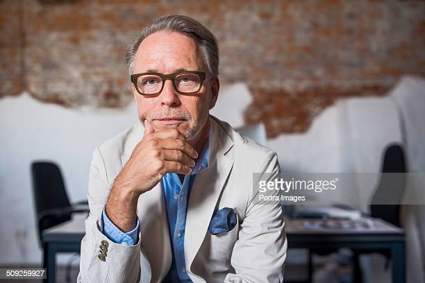 Portrait of serious businessman in creative office