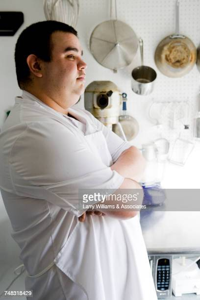 Portrait of serious chef in commercial kitchen with arms crossed