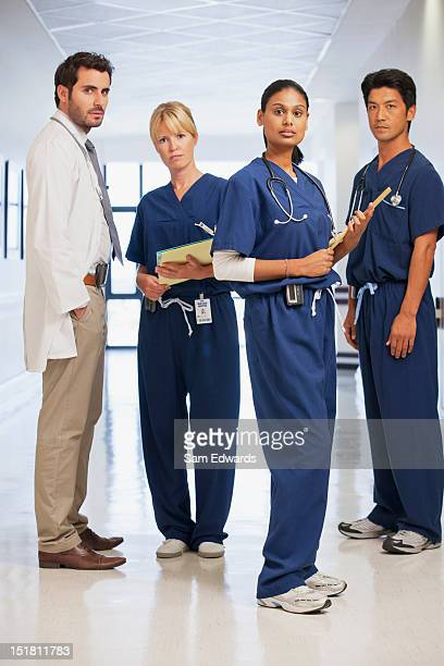 Portrait of serious doctor and nurses