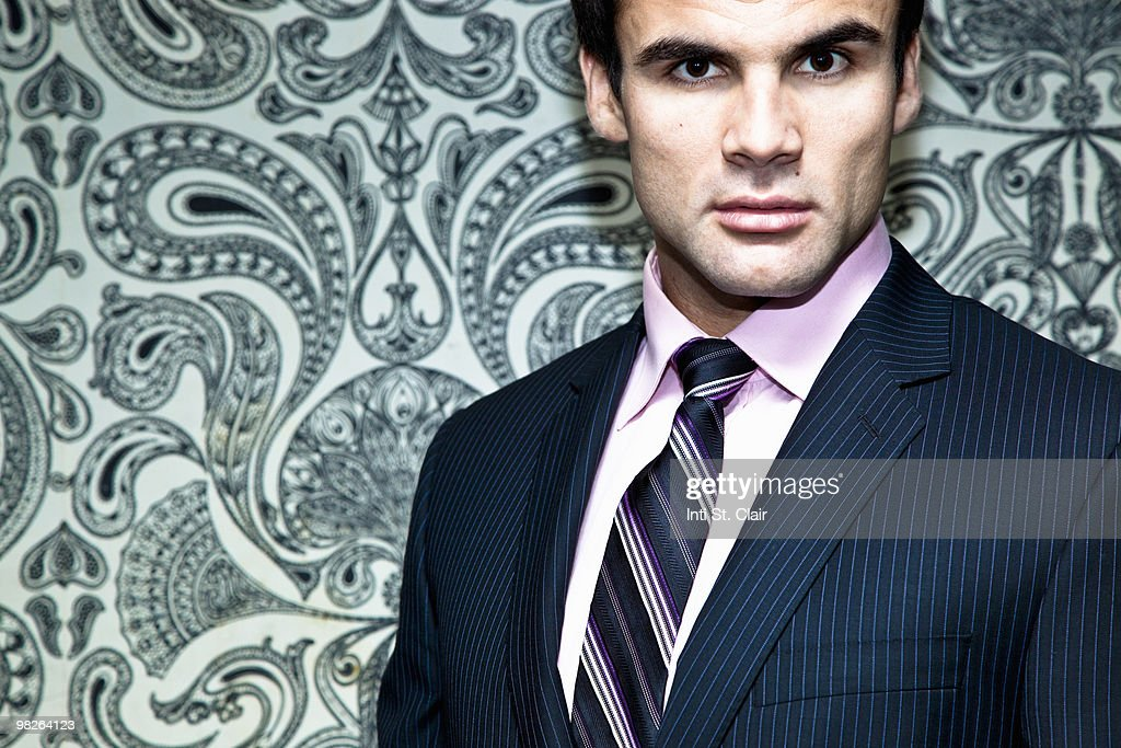 Portrait of serious man in business suit : Stock Photo