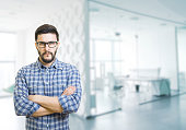Bearded man with eyeglasses in office