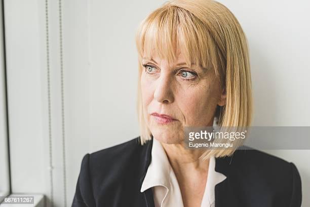 Portrait of serious mature businesswoman looking sideways