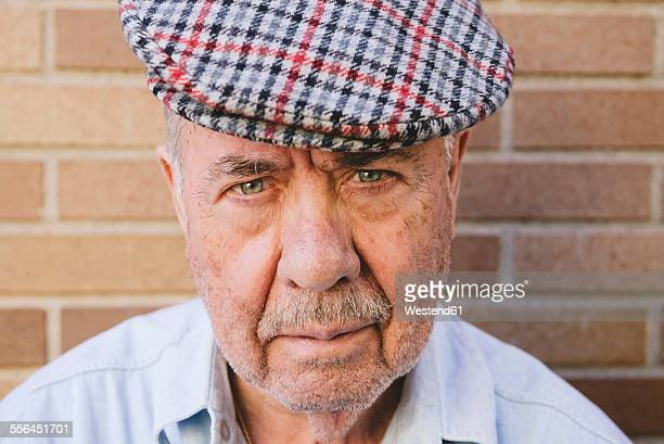 Portrait of serious old man wearing beret