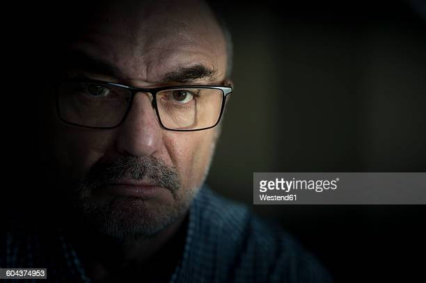 Portrait of serious senior man wearing glasses