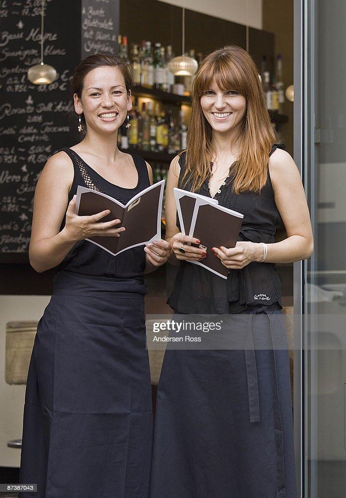 Portrait of servers in doorway : Stock Photo