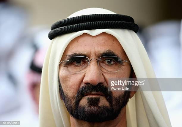 A portrait of Sheikh Mohammed bin Rashid Al Maktoum ruler of Dubai looks on during the Dubai World Cup at the Meydan Racecourse on March 29 2014 in...