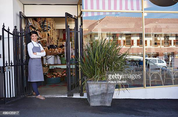 Portrait of shop owner in front of store