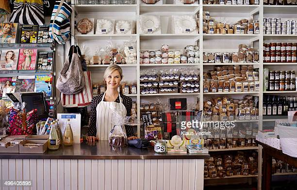 Portrait of shop owner standing behind the counter
