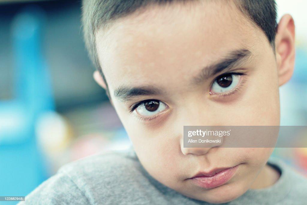 Portrait of shy boy : Stock Photo