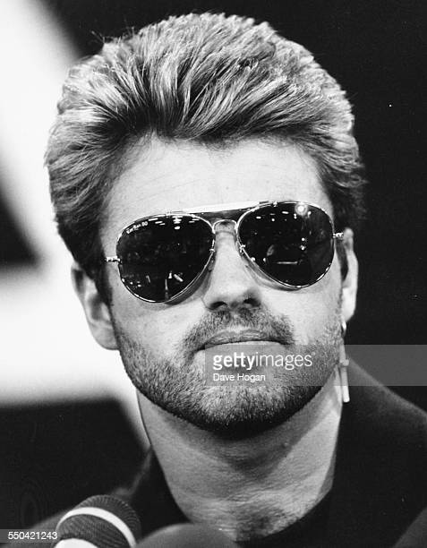 Portrait of singer George Michael wearing sunglasses April 15th 1988