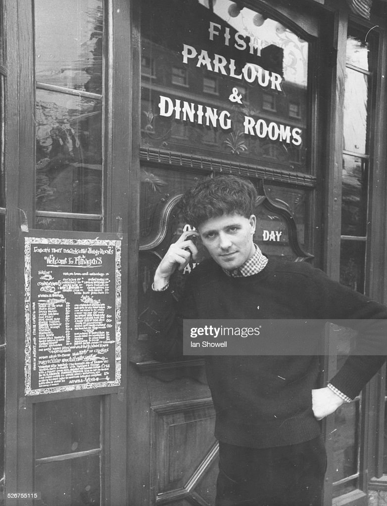 Portrait of singer Gilbert O'Sullivan standing outside a Flanagan's Eating House in Baker Street where he gave an impromptu performance London August...
