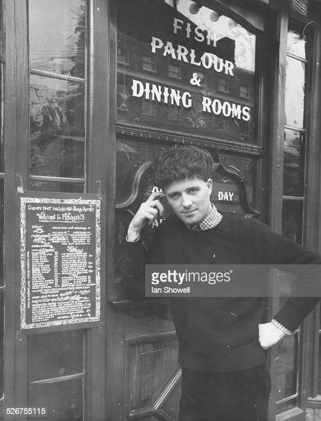Portrait of singer Gilbert O'Sullivan standing outside a Flanagan's Eating House in Baker Street where he gave an impromptu performance London August...