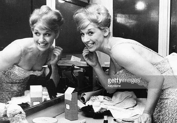 Portrait of singer Jackie Trent applying mirror in her dressing room preparing to go on stage as a replacement for singer Cilla Black at the London...