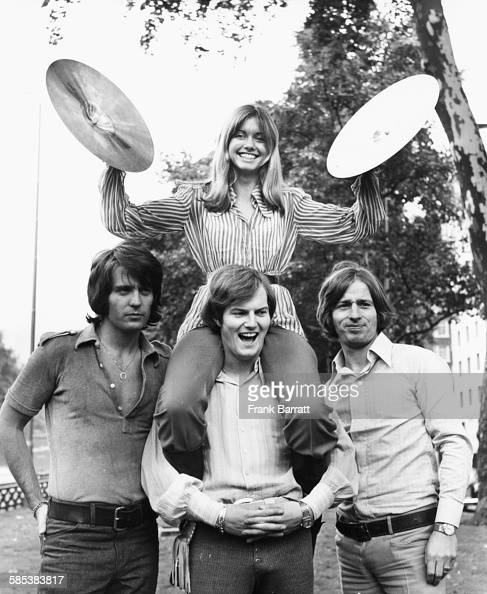 Portrait of singer Olivia Newton John and the band 'Tomorrow' Ben Thomas Chris Slade and Vic Cooper at Park Lane London August 25th 1970