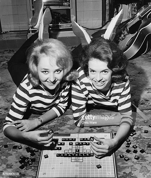 Portrait of singers Andrea Simpson and Lois Wilkinson or 'The Caravelles' wearing matching striped blouses as they spell out their single 'You Don't...
