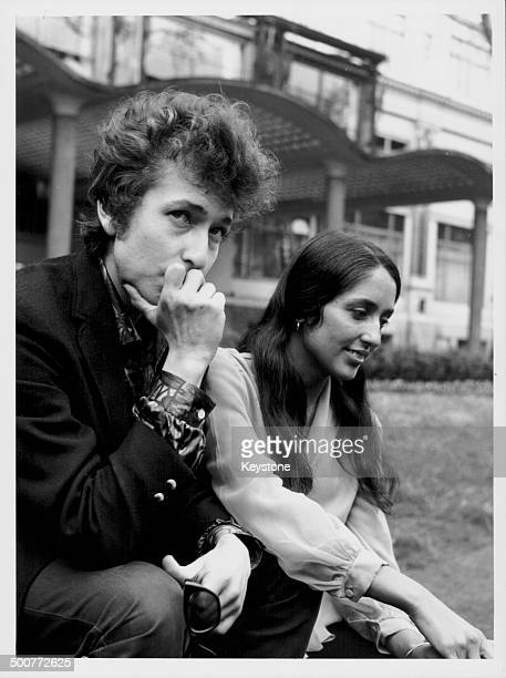 Portrait of singers Bob Dylan and Joan Baez sitting together in Embankment Gardens London April 27th 1965