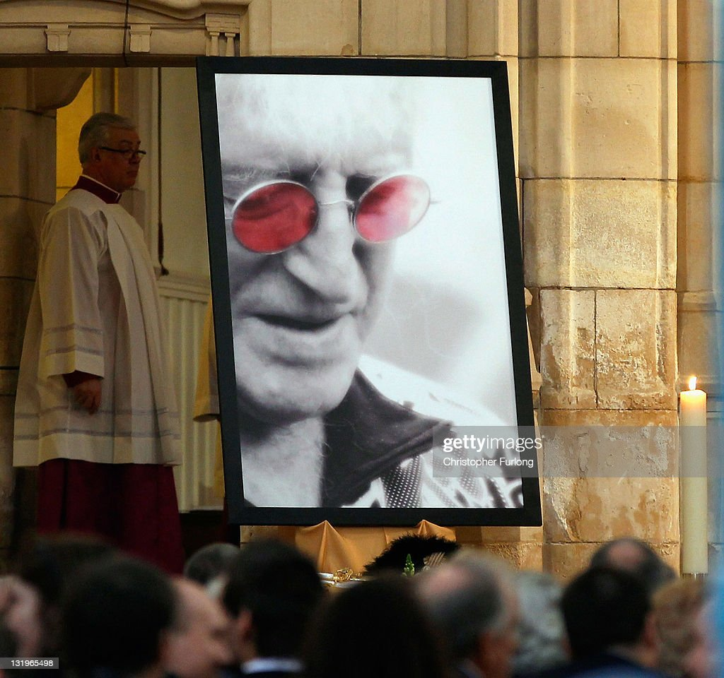 A portrait of Sir Jimmy Savile adorns the inside of Leeds Cathedral during his funeral service on November 9, 2011 in Leeds, England. Members of the public, fans and family are paying their respects to the television and radio celebrity who will be buried tomorrow in Scarborough.