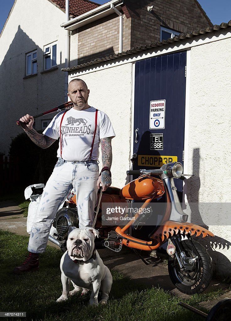 Portrait of Skinhead male with his dog : Stock Photo