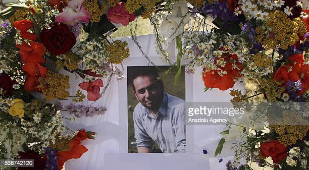A portrait of slain Journalist Zabihullah Tamanna covered with flowers on his grave in Kabul Afghanistan on June 8 2016 Anadolu Agency freelancer...