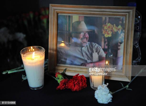A portrait of slain Mexican Journalist Javier Valdez is displayed during a tribute organized by colleagues relatives and civil organizations in...