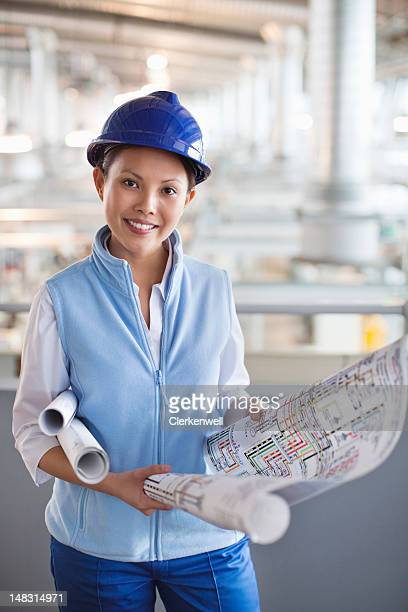 Portrait of smiling architect with blueprints