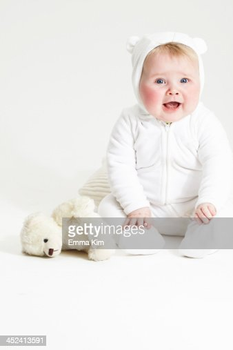 Portrait of smiling baby girl and teddy bear