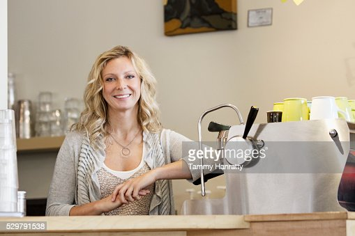 Portrait of smiling barista : Stock Photo