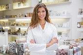Portrait of smiling beautician at a beauty salon