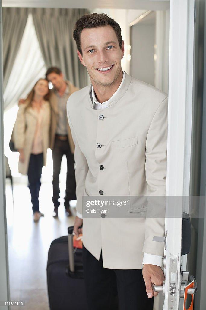 Portrait of smiling bellman in hotel doorway