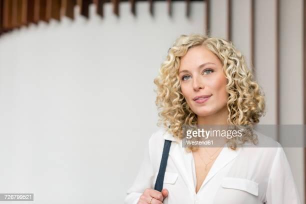 Portrait of smiling blond businesswoman
