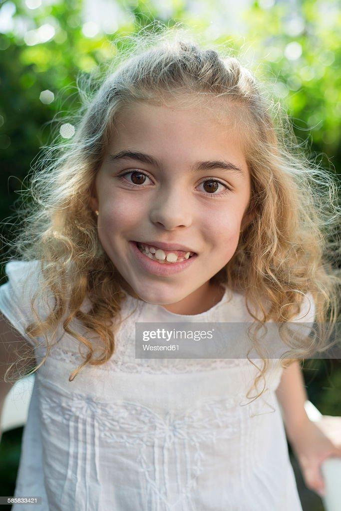 Portrait of smiling blond girl