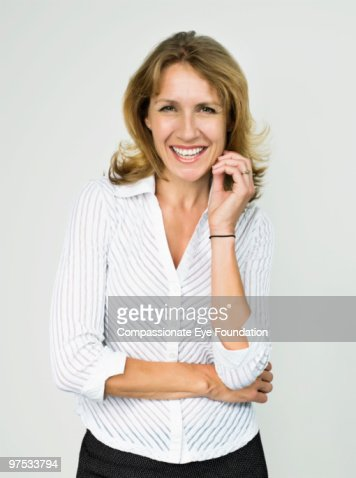 Portrait of smiling blond woman : Stock Photo