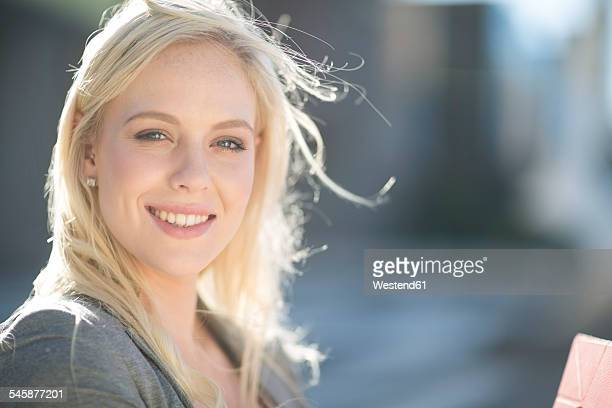 Portrait of smiling blond young woman