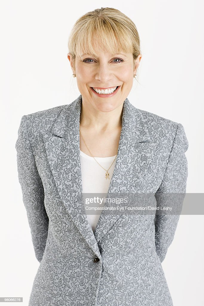Portrait of smiling blonde business woman : Stock Photo