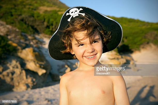 Portrait of smiling boy wearing pirates hat on the beach