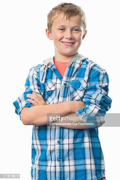 Portrait of smiling boy (9-11) with arms folded