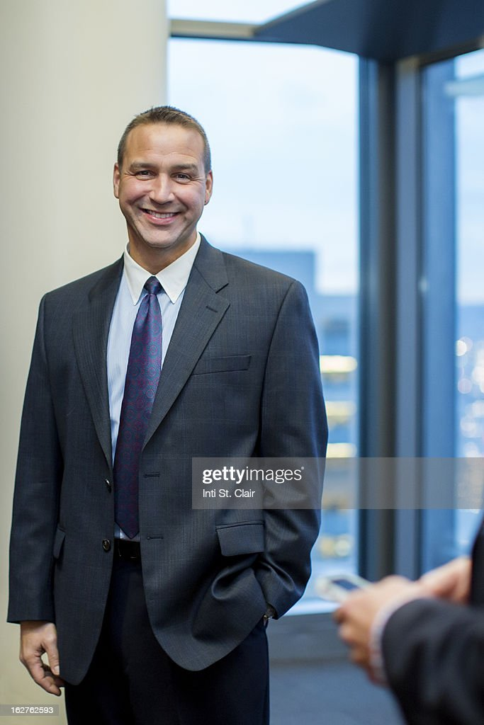 Portrait of smiling business man in suit : Stock Photo