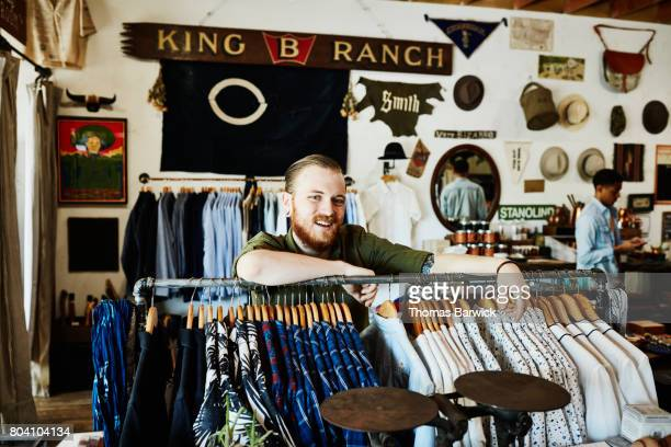 Portrait of smiling business owner in mens boutique