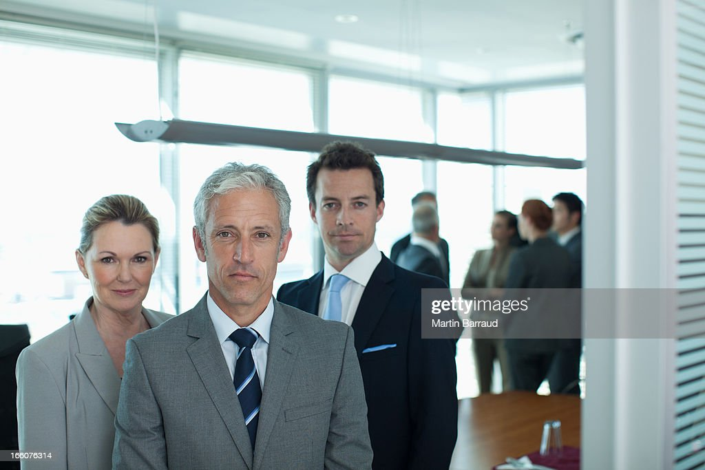 Portrait of smiling business people in conference room : Stock Photo