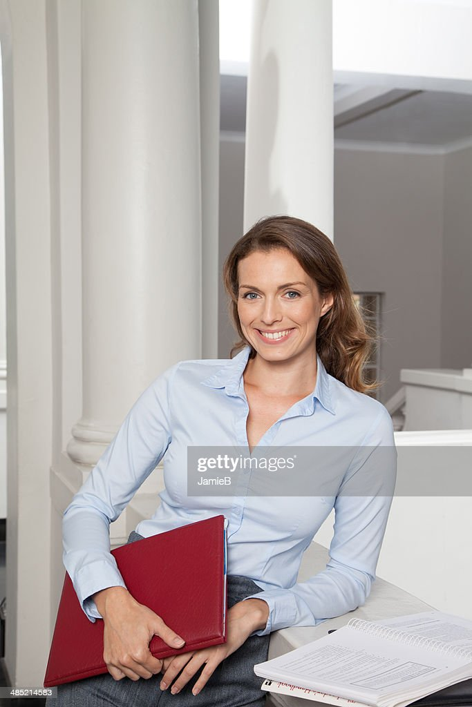 Cape Town, South Africa, Portrait of teacher in school building : Stock Photo