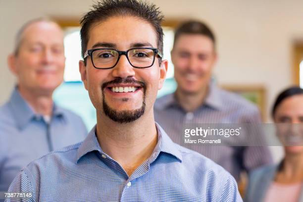 Portrait of smiling businessman and team