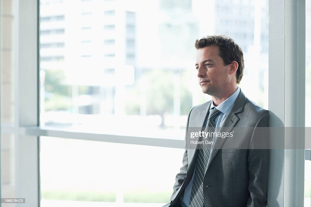 Portrait of smiling businessman in corridor : Stock Photo