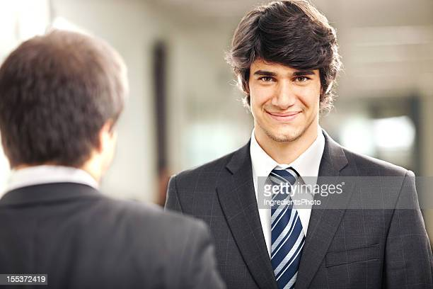 Portrait of smiling businessman in the office place.