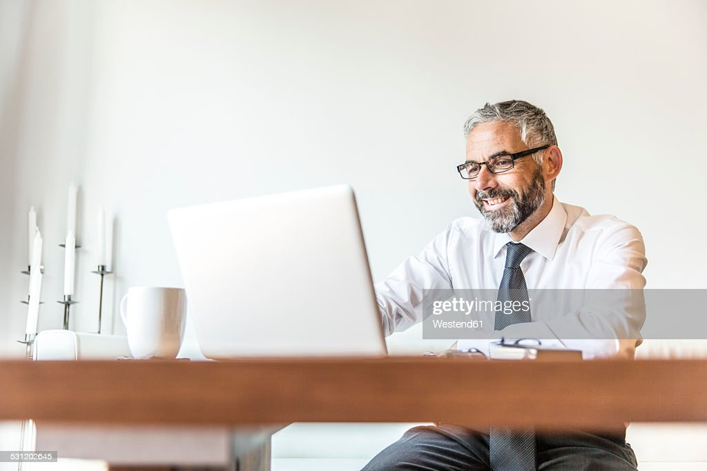 Portrait of smiling businessman working at home office
