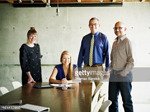 Portrait of smiling businessmen and businesswomen