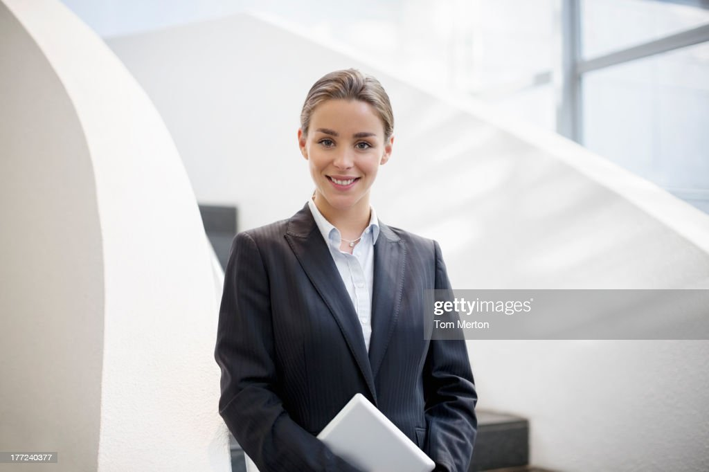 Portrait of smiling businesswoman holding digital tablet : Stock Photo
