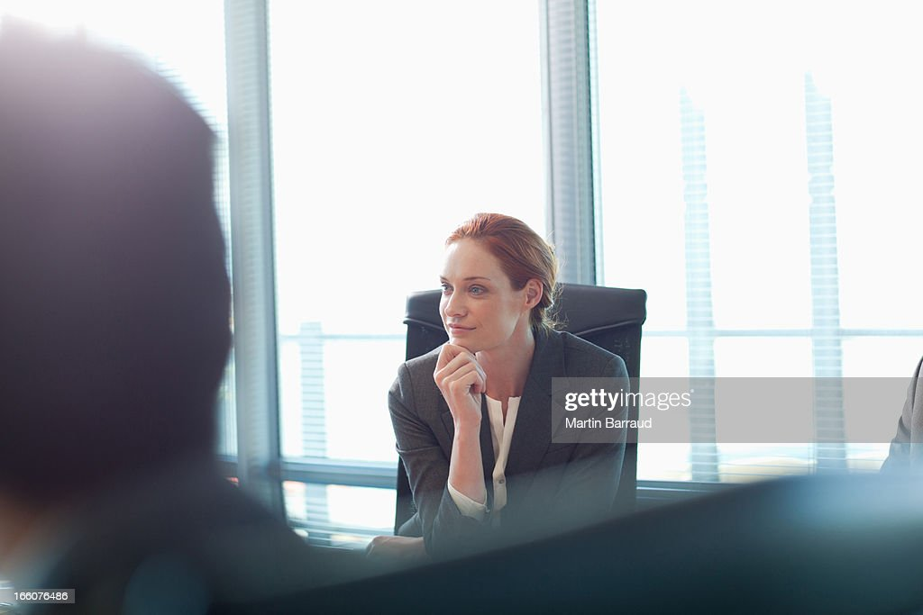 Portrait of smiling businesswoman in meeting : Stock Photo