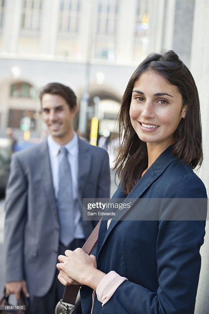 Portrait of smiling businesswoman on urban street : Stock Photo