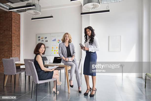 Portrait of smiling businesswomen at board room