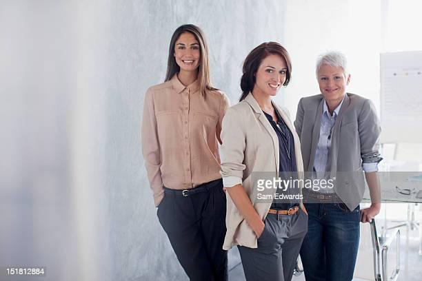 Portrait of smiling businesswomen in office